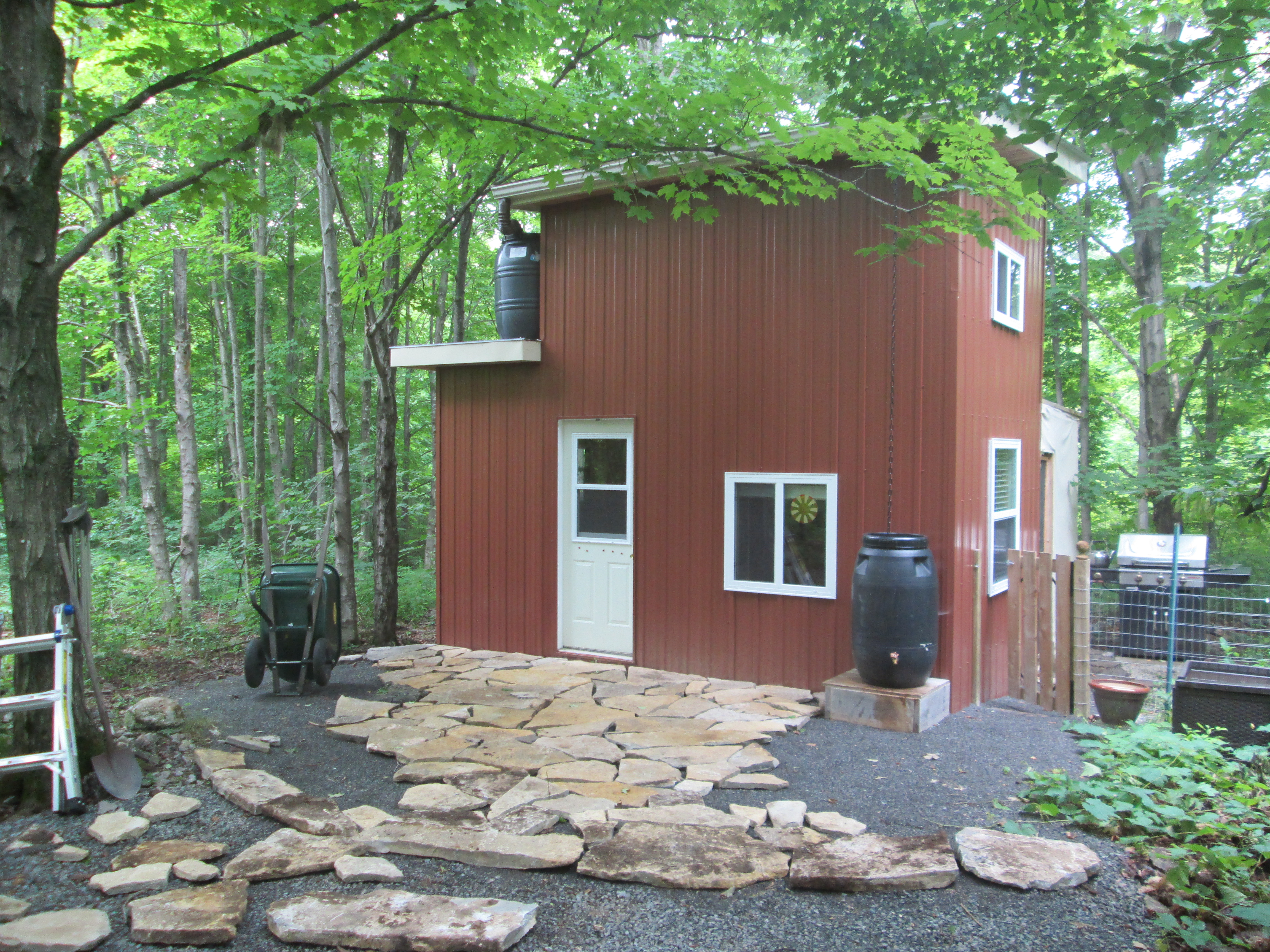 Man of stone tiny house ontario for Tiny homes on foundations