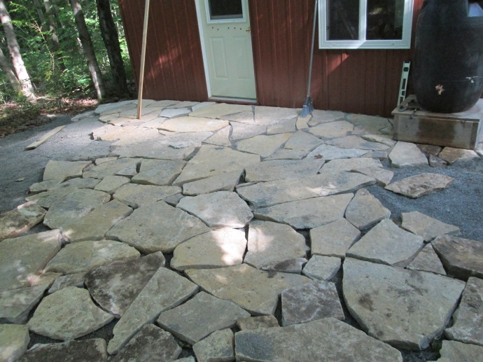 most of the stone is laid for the planned patio.