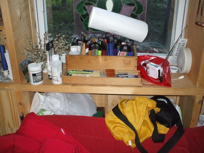 Paints and supplies on the window shelf